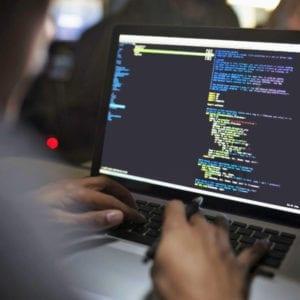 Haitian Developer & Programmer coding