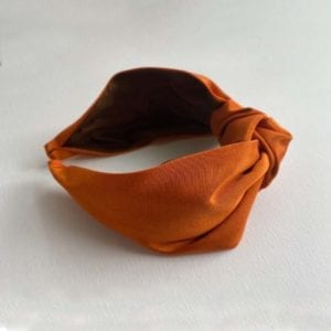 Terracota Headbands by Moonkaii laid on a surface